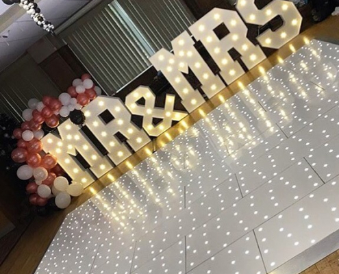 LED dance floors image with large light up letters