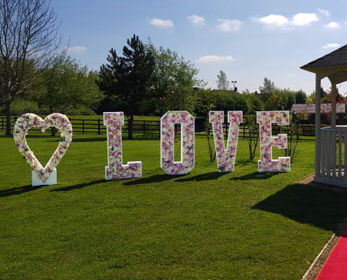 Large love letters at weddings in Cheshire